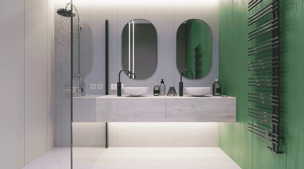 Szara łazienka w apartamencie z zielonym akcentem